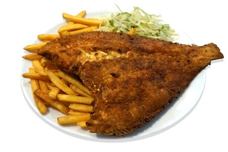 Fried fish - flounder, salad and french fries on plate