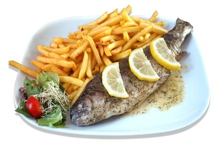 Baked fish - trout, salad and french fries on plate