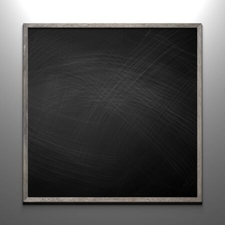 Rubbed out chalk on a blackboard with wooden frame