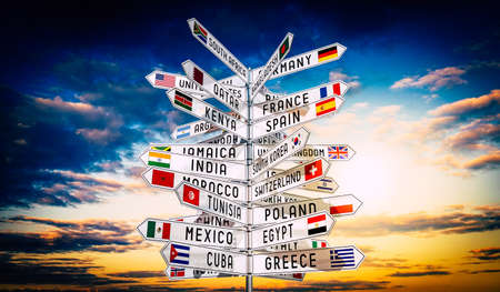 Signpost with national flags of different countries, sky in background - 3D illustration Stockfoto