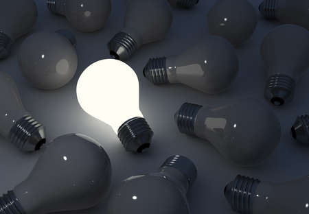Light bulbs. Standing out from the crowd. (Digitally generated image) photo