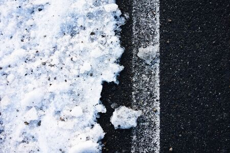 Snow on the side of the road, view from above. Abstract winter background photo. Reklamní fotografie