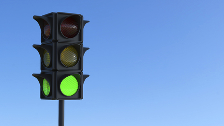 3D illustration green traffic light on a blue city sky Stock Photo