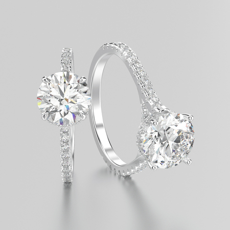 platinum: 3D illustration two white gold or silver diamonds rings with reflection on a grey background