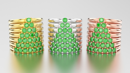3D illustration three different gold decorative diamond rings with green emerald diamonds in the form of a сhristmas tree on a grey background