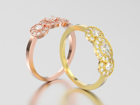 3D illustration two rose and yellow gold  three stone solitaire engagement rings on a gray background Stock Photo