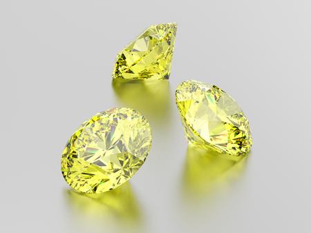 3D illustration three yellow round diamond stone on a gray background Stock Photo