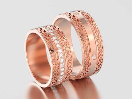 3D illustration two rose gold decorative wedding bands carved out rings with ornament on a gray background Stock Photo