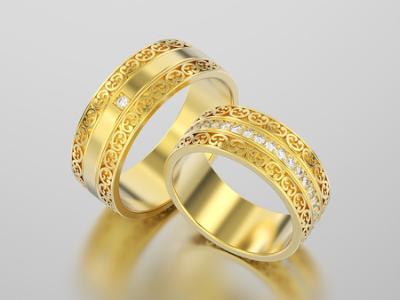 3D illustration two yellow gold decorative wedding bands carved out rings with ornament on a gray background Stock Photo