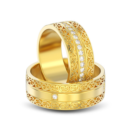 3D illustration isolated two yellow gold decorative wedding bands carved out rings with ornament with shadow on a white background Stock Photo