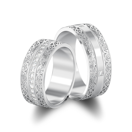 3D illustration isolated two silver decorative wedding bands carved out rings with ornament with shadow on a white background Stock Photo