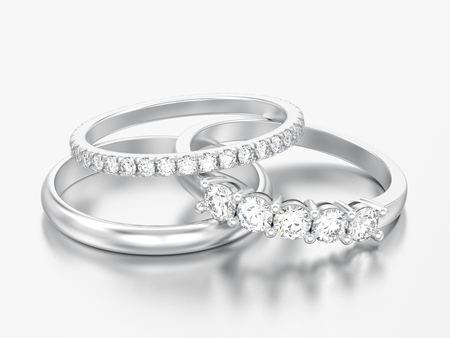 3D illustration three different white gold or silver diamonds rings on a grey background Foto de archivo