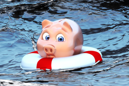 Piggy bank in the water Stock Photo