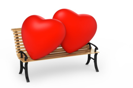 cordiality: two hearts on a garden bench Stock Photo