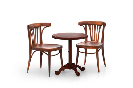 round chairs: Two bistro chairs with table Stock Photo