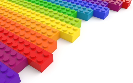 Colored toy bricks on white background photo