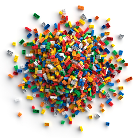 Pile of colored toy bricks isolated on white background
