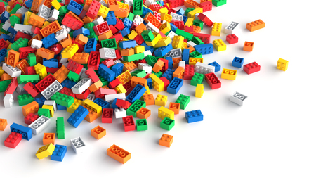 Pile of colored toy bricks on white background 写真素材