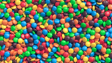 Huge pile of colorful coated chocolate candies background