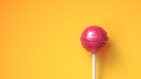 Sweet lollipop on bright yellow background with copy space Stock fotó