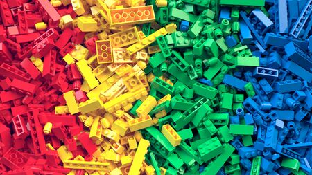 Lot of colorful toy bricks background. Educational toys for children.