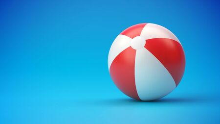 Red and white beach ball on blue gradient background