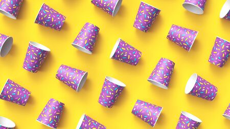 Paper cups with colorful sprinkles pattern diagonally arranged on yellow background
