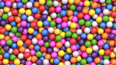 Colorful gumballs background. Assorted brightly colored candy gumballs or dragees Archivio Fotografico