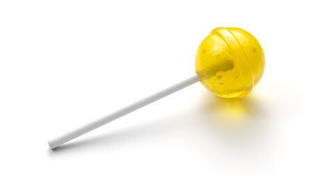 Sweet yellow lollipop on stick isolated on white background