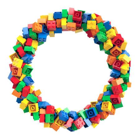 Colorful toy bricks randomly arranged in circle frame. 3d rendering Archivio Fotografico