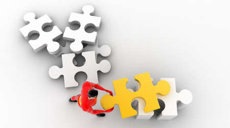 arranging: 3d superhero arranging jigsaw puzzle pieces concept on white background, top angle view Stock Photo