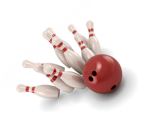 Bowling ball crashing into the pins isolate on white background. photo