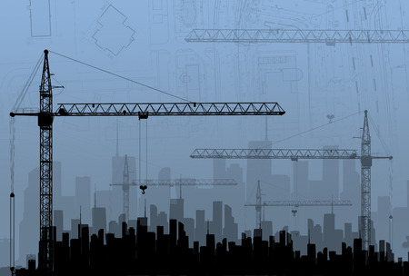 Construction cranes on the background buildings. The concept of building. photo