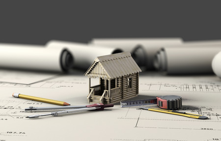 architect office: Tools of the architect and the wooden house on the sheets of drawings. 3d illustration. Stock Photo