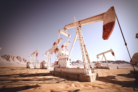 drilling well: Oil pump jack rocking  Stock Photo