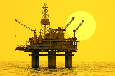 Afbeelding van olieplatform tijdens zonsondergang Stockfoto