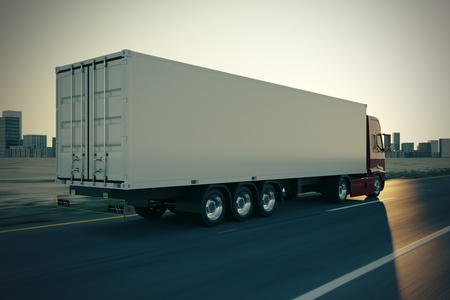 Large delivery truck is moving fast on the road while sunset Imagens - 17456312
