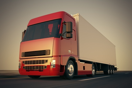Large delivery truck is moving fast on the road while sunset