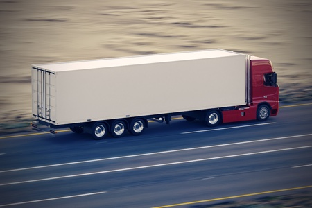 Large delivery truck is moving fast on the road Stock Photo - 17456331