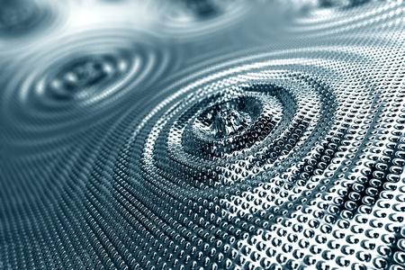 Abstraktní pozadí vlny v lesklé stříbrné temperované platiny, které tvoří soustředné kruhy kolem centrálního kapičky s celkovým roztíranou členitého povrchu účinkem Reklamní fotografie