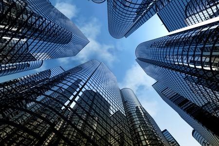 흐린 하늘 배경으로 현대 유리 도시 건물의 낮은 각도 샷.