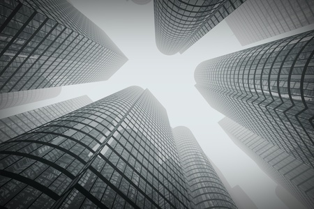 Low angle shot of modern glass city buildings in fog.  Stock Photo