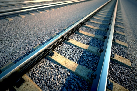 Close up of empty straight railroad track. Perspective view. Фото со стока