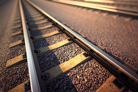 Close up of empty straight railroad track. Perspective view. Imagens
