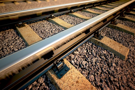 train tracks: Close up of empty straight railroad track. Perspective view. Stock Photo