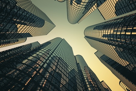 Low angle shot of modern glass city buildings with sunset background. Stock Photo