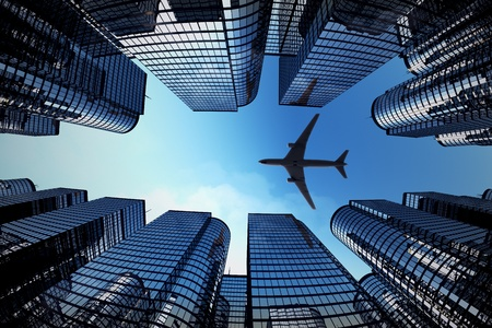 aeroplane: Shot of airplane flying above glass office buildings. Fisheye lens effect. Stock Photo