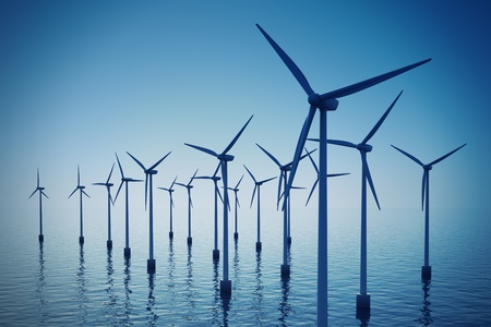 Alternative energy- shot of floating wind turbine farm during foggy day. Stock Photo