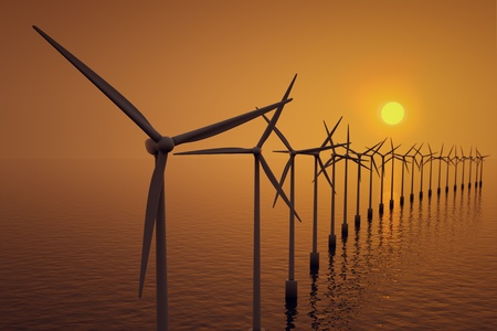 Alternative energy- row of floating wind turbines during sunset. Stock Photo