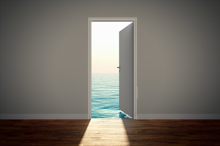 View of the calm sea, seen through an open door.